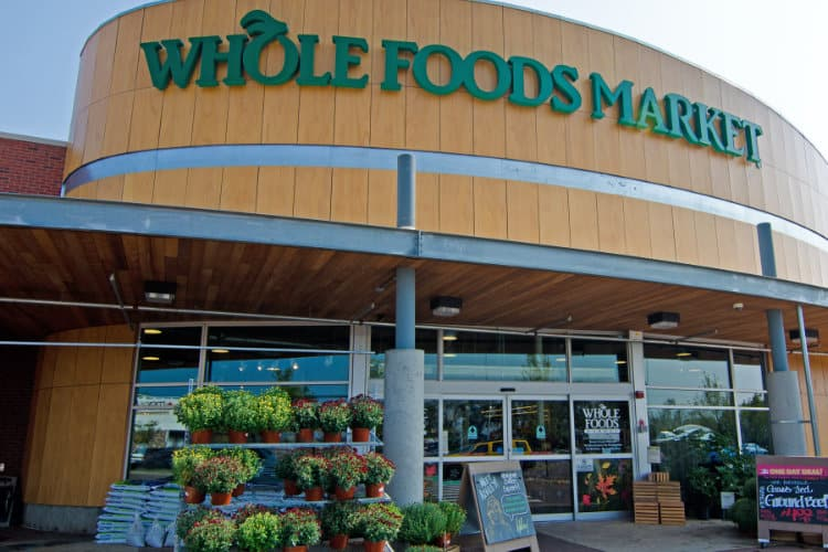 Amazon cuts Whole Foods prices as much as 43% on first day