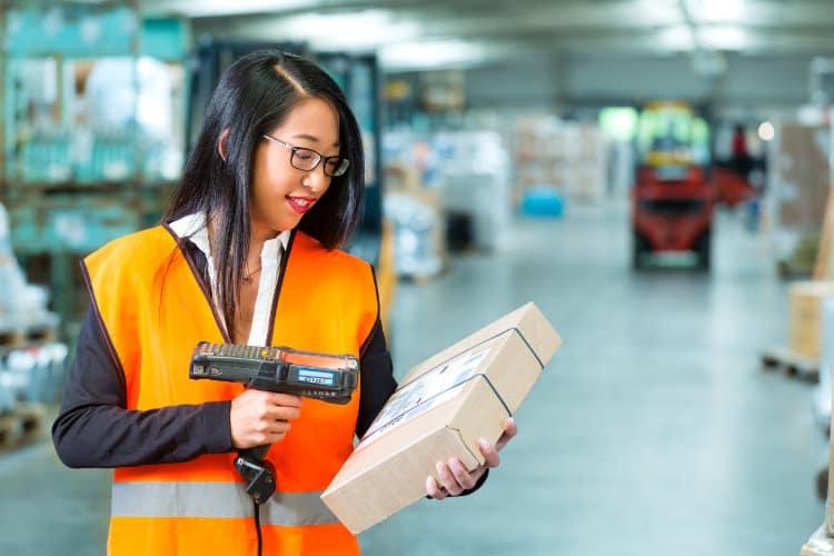 Image: Adobe | Female Worker Scanning Package