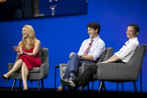 Image: Alibaba | Michele Romanow (l) with Canadian Prime Minister Justin Trudeau and Jack Ma during a fireside chat at Monday's Gateway Canada event.
