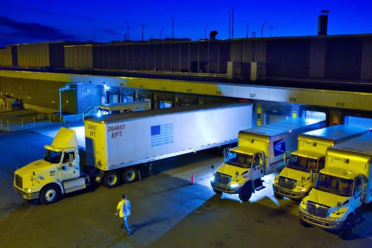 usps trucks at mail distribution center