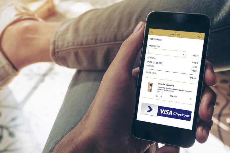 visa checkout mobile screen in hand