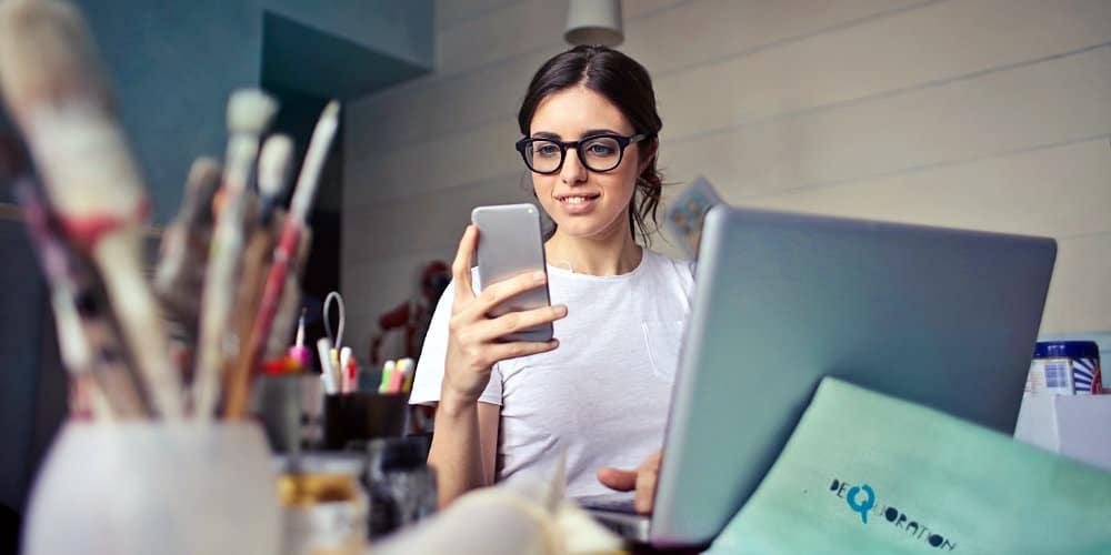 woman looking smartphone computer graphics supplies