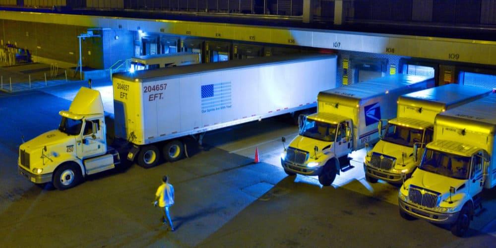 usps facility dock night trucks