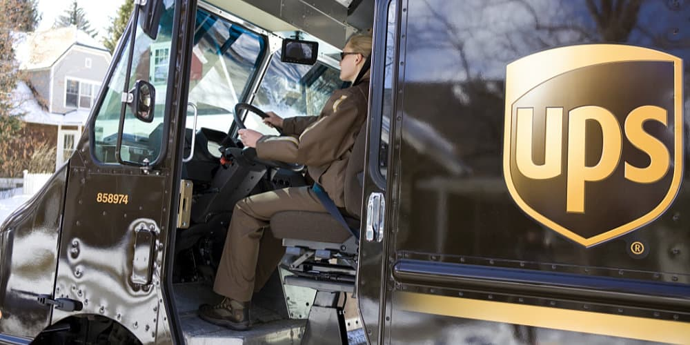 ups female driver delivering residential area