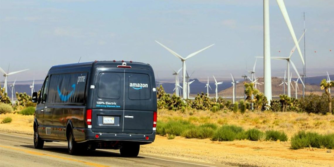Amazon electric delivery van driving by wind farm