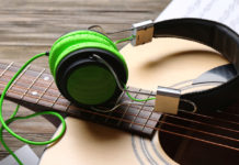 Guitar with green headphones