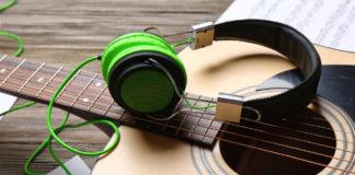 Guitar with green headphones