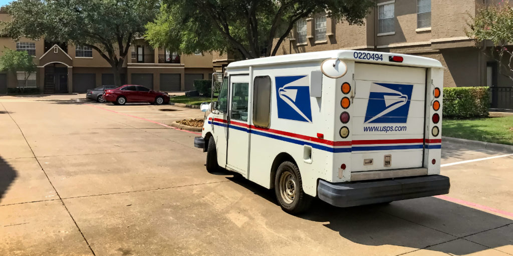 USPS vehicle parked in residential neighborhood