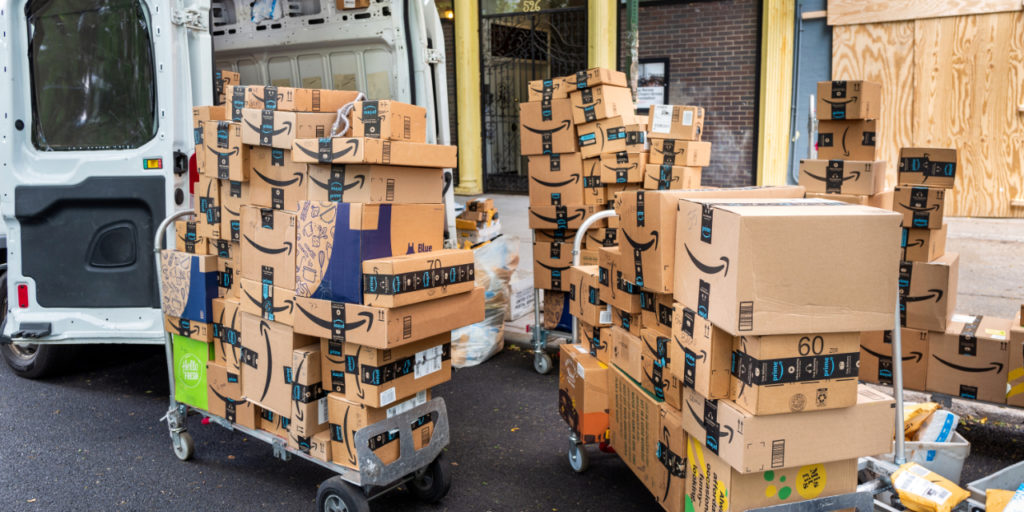 Amazon deliveries ready to be loaded into van