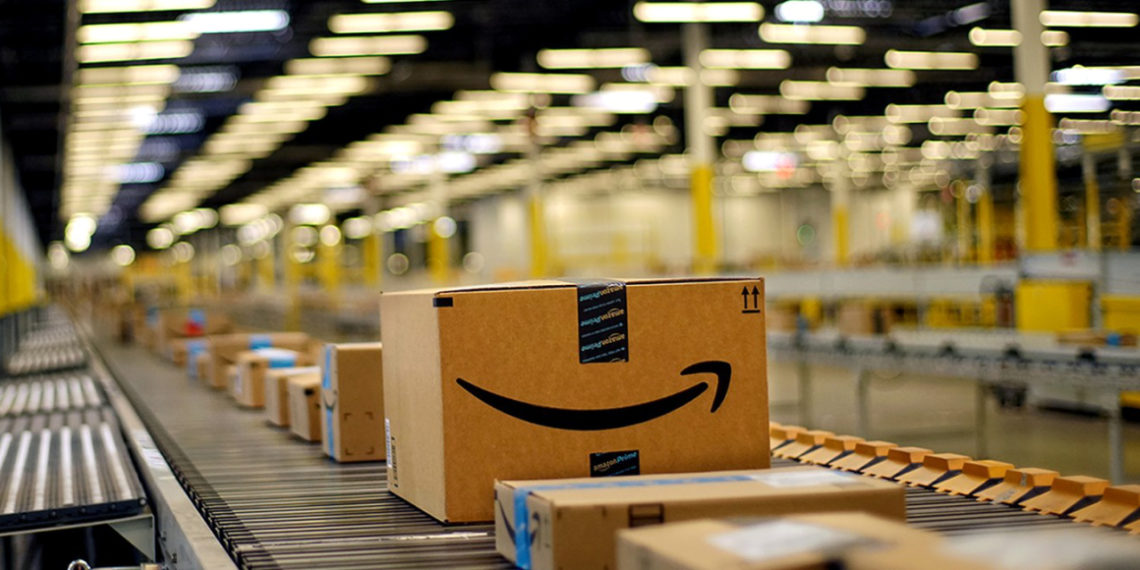 Amazon packages moving on convyor belt in fulfillment warehouse