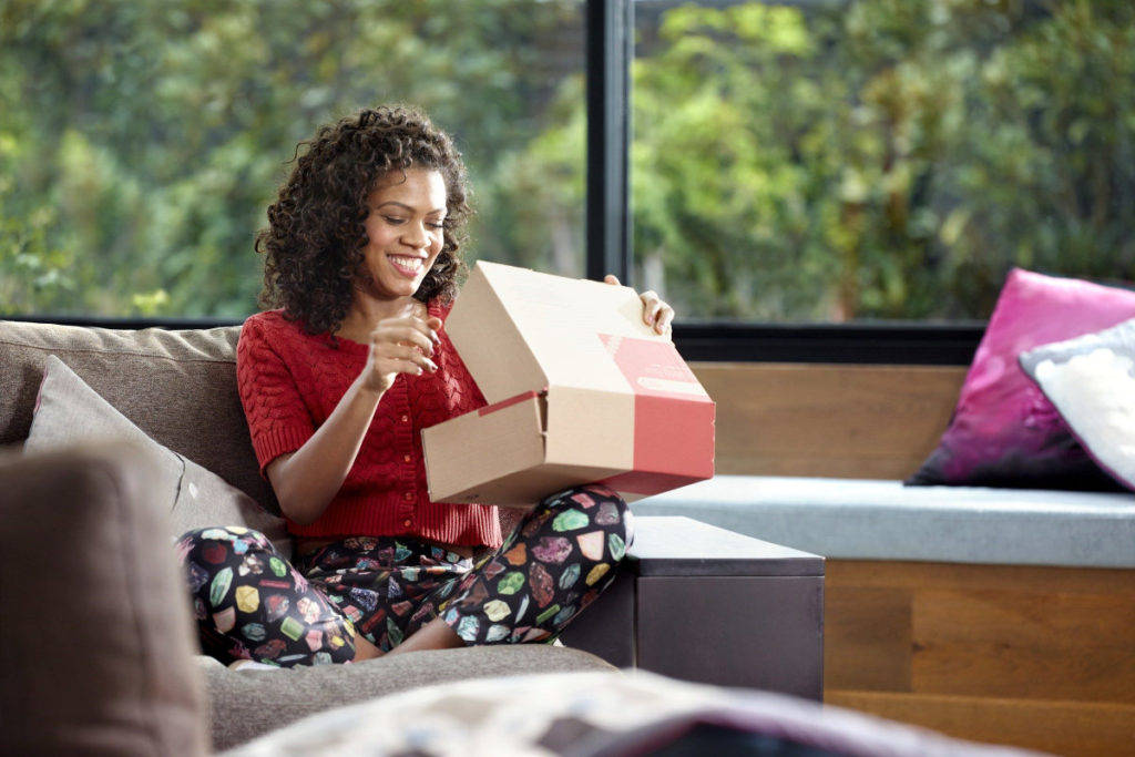Young woman opening package