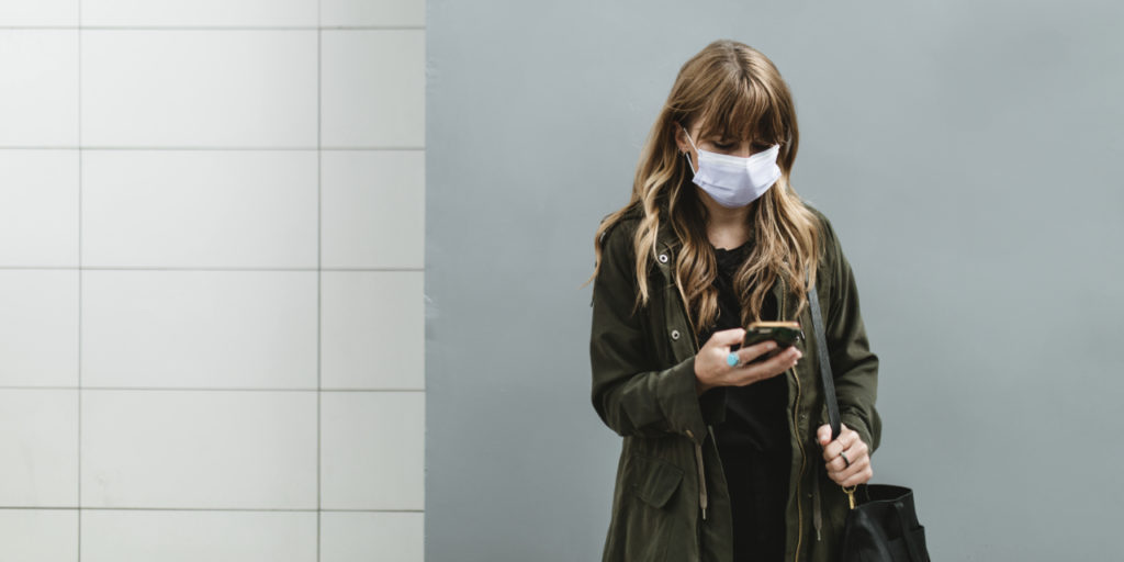 Woman wearing a face mask in public during coronavirus pandemic