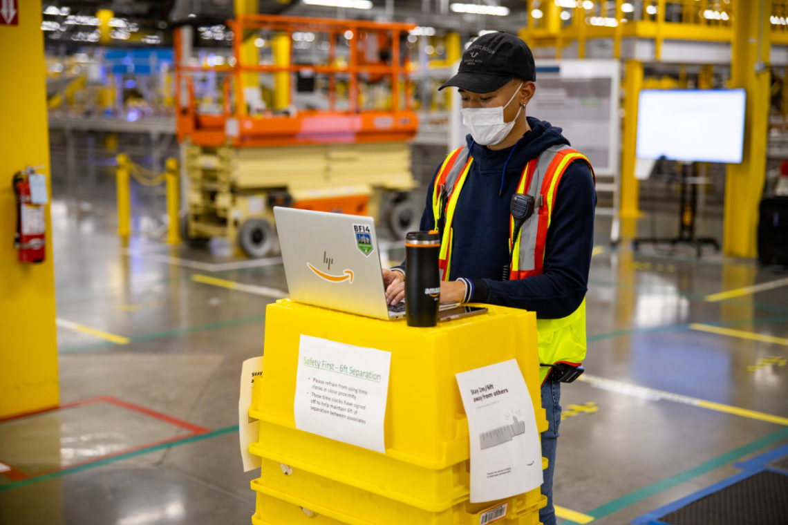 Amazon worker in a fulfillment center