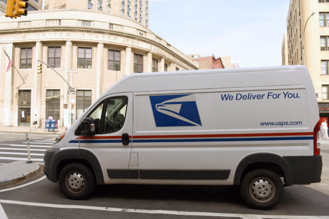 USPS delivery van parked in NYC