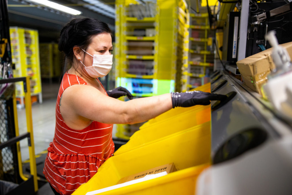Amazon associate working in fulfillment center