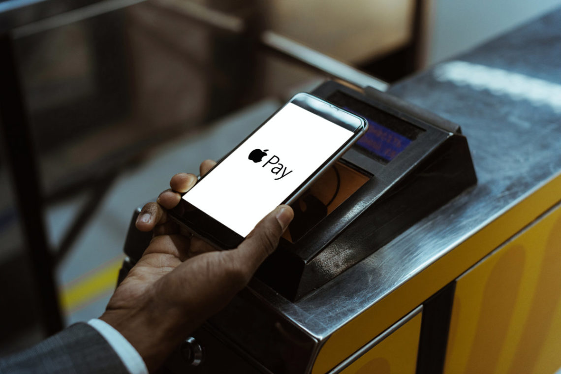 Person using Apple Pay at retailer terminal