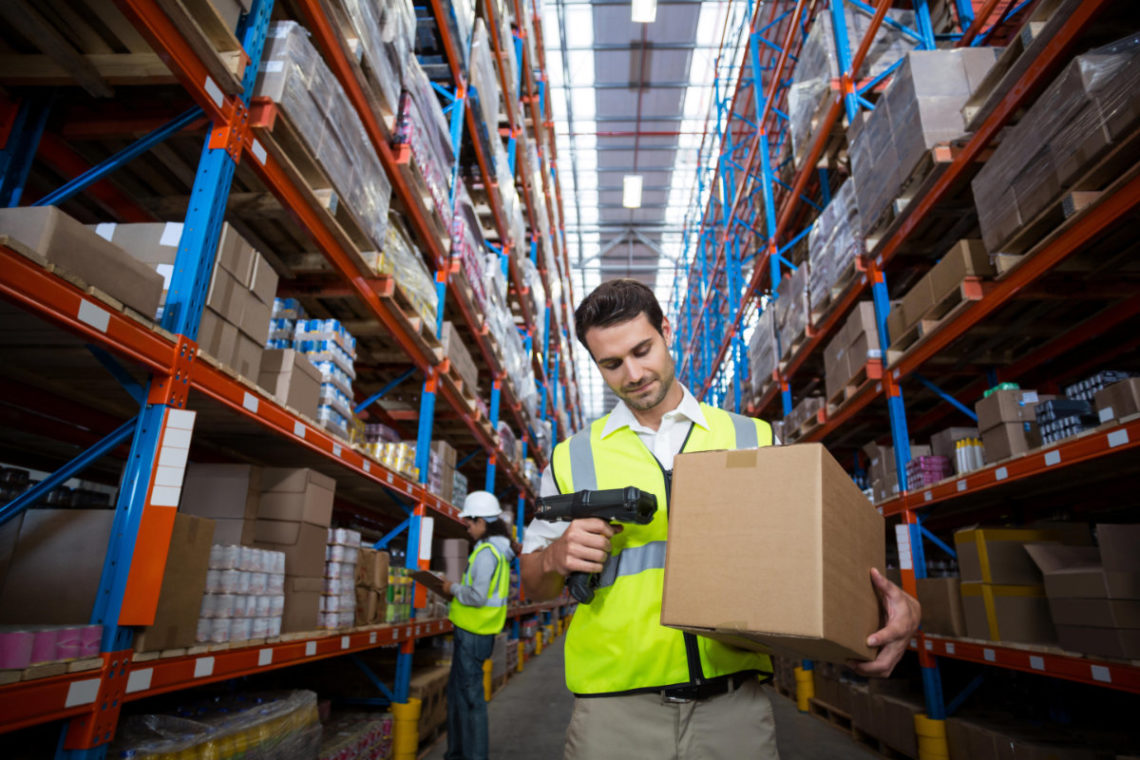 Warehouse worker scanning a package