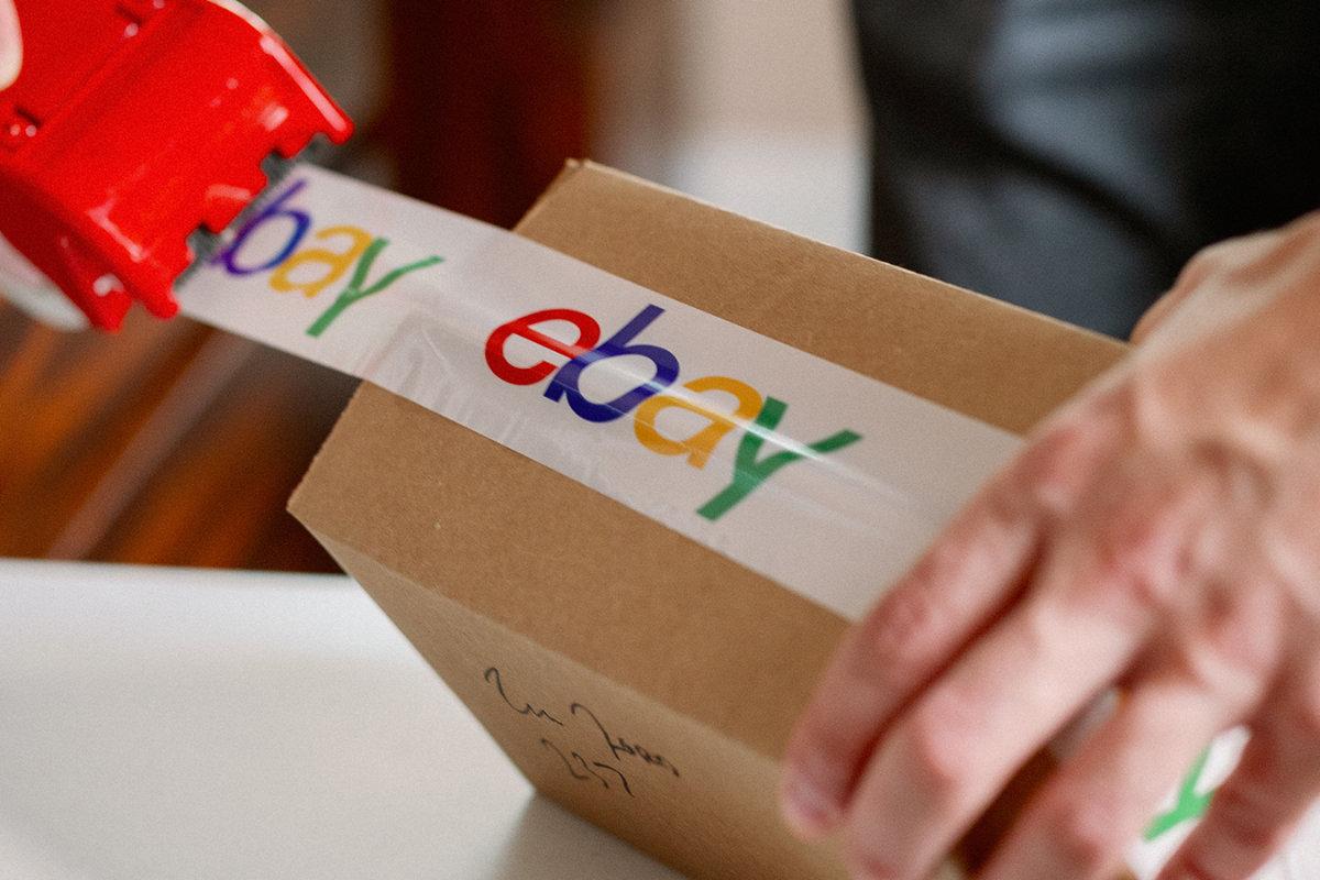 eBay seller packing order using eBay branded tape