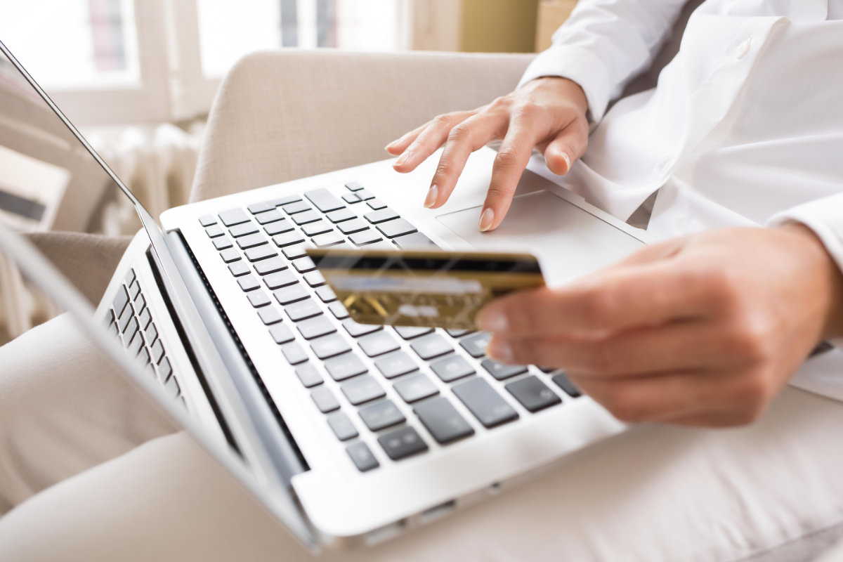 Woman shopping online and paying with credit card