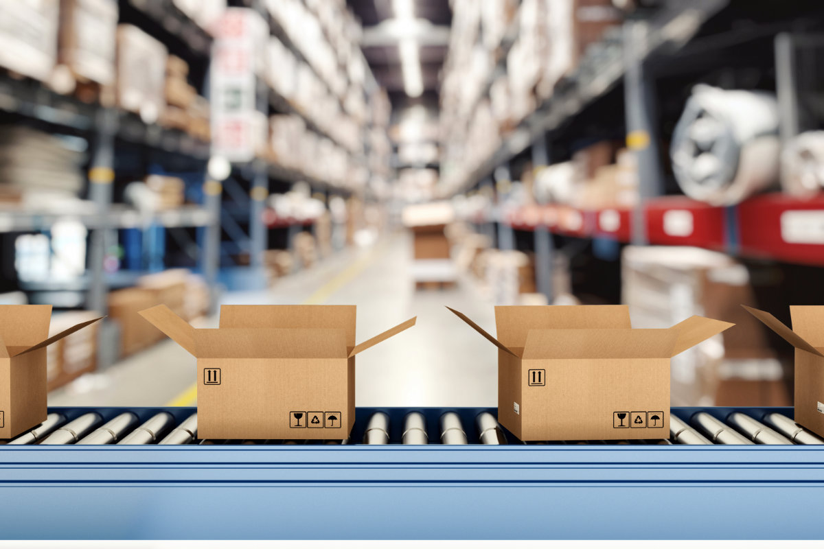 Boxes on conveyor belt in warehouse