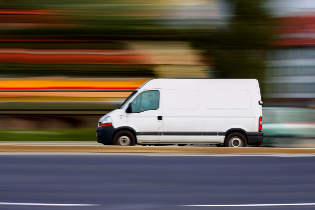 White cargo van in motion