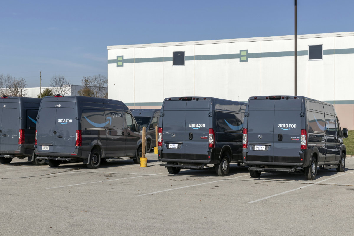 Amazon delivery vans parked at fulfillment center