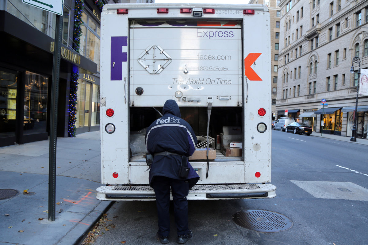 FedEx Express driving making deliveries in Manhattan during holiday season