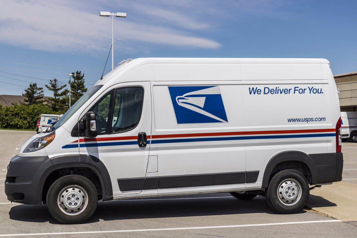 USPS mail truck parked at post office
