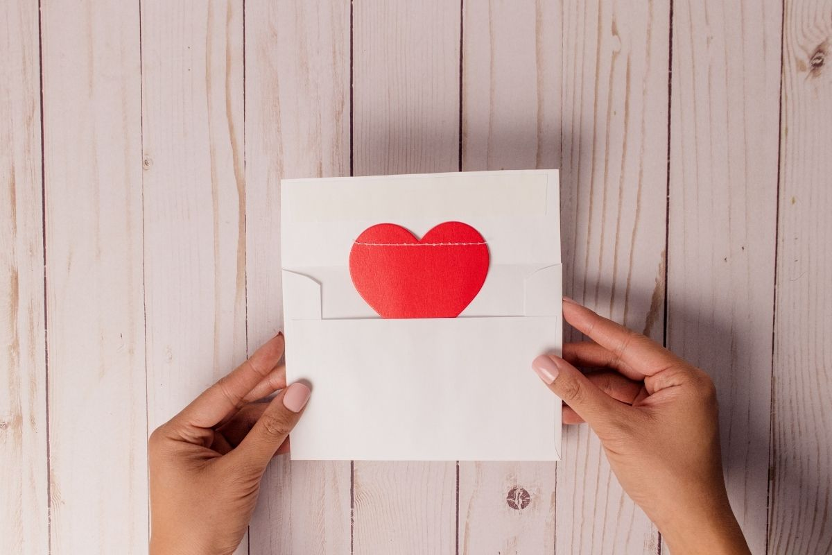 an envelope with a heart inside