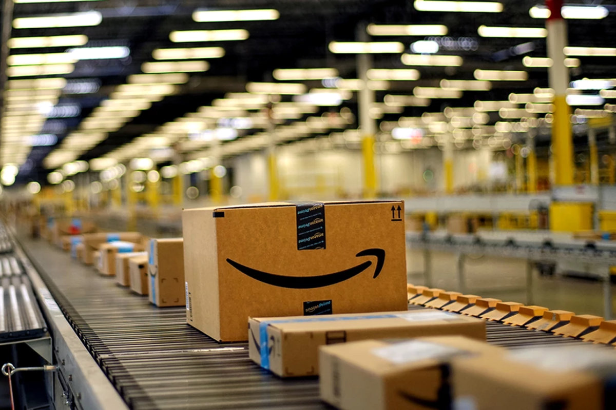 Amazon packages on conveyor belt in fulfillment center