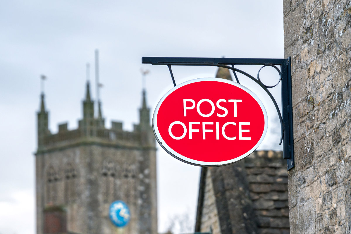 Post Office sign in rural location, England, United kingdom