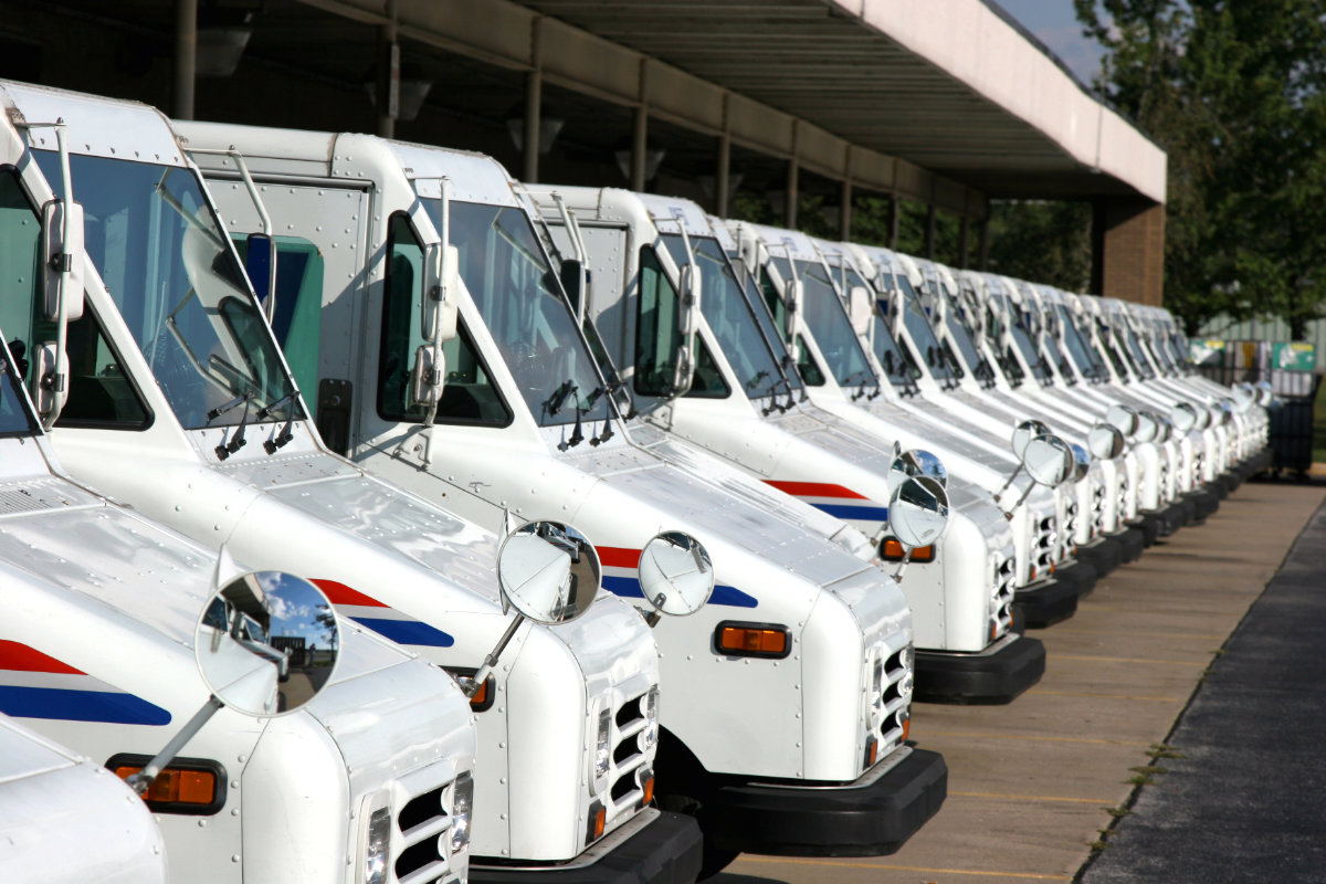 USPS delivery vehicles parked at post office
