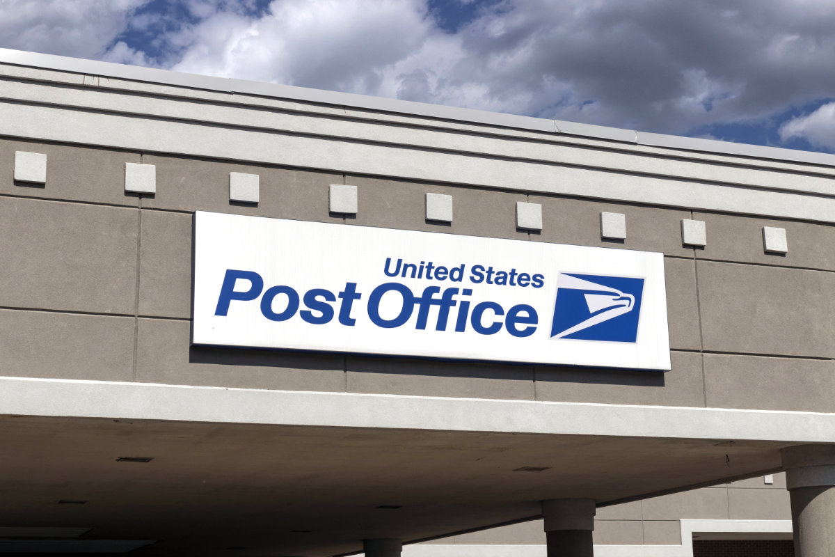 USPS sign at entry to post office