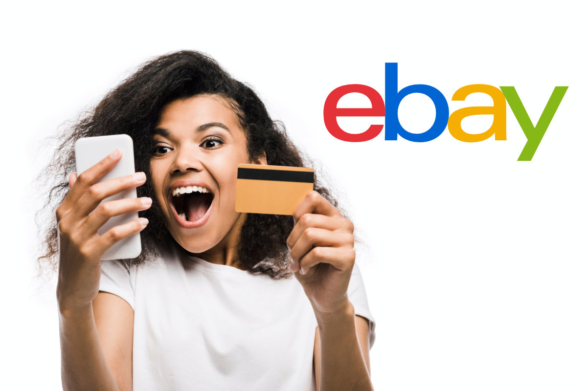 Young woman shopping on smartphone with credit card / eBay logo