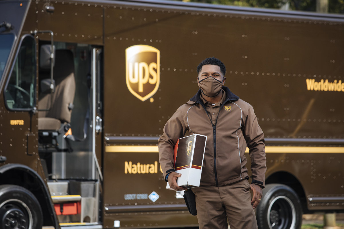 UPS delivery driver carrying express package
