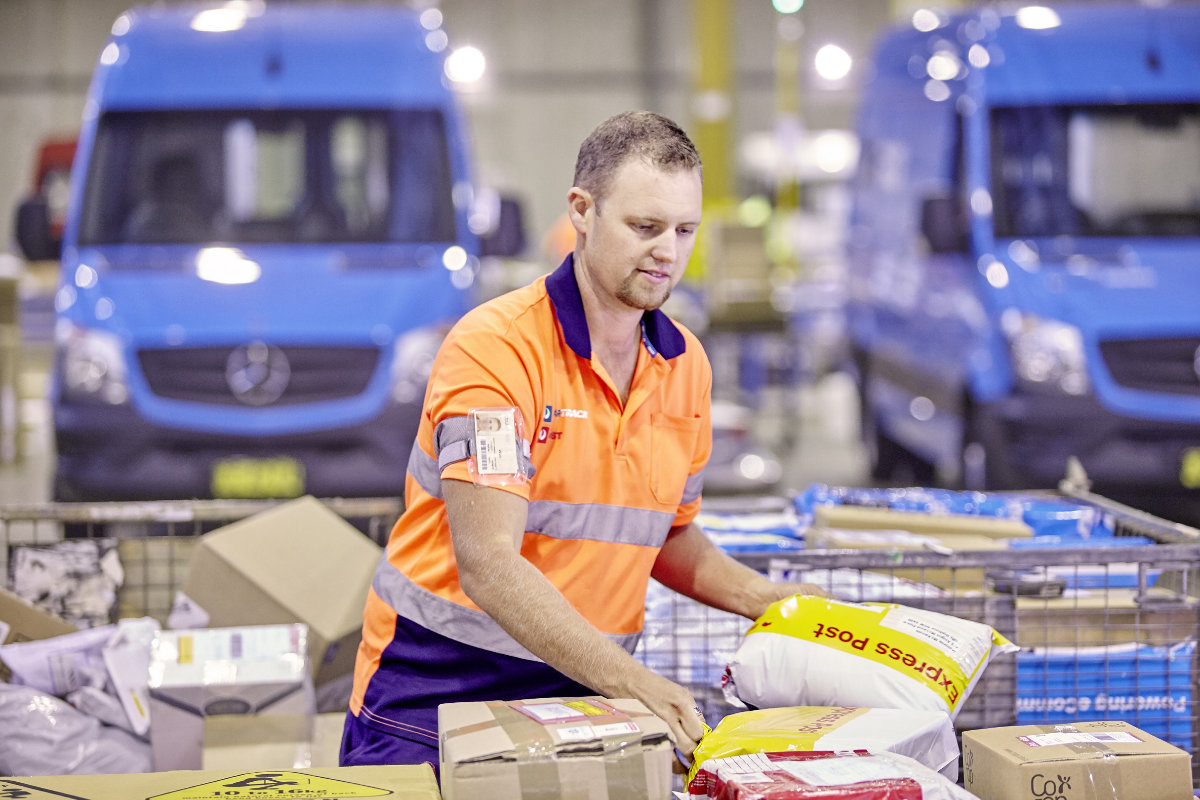Australia Post worker sorting parcels