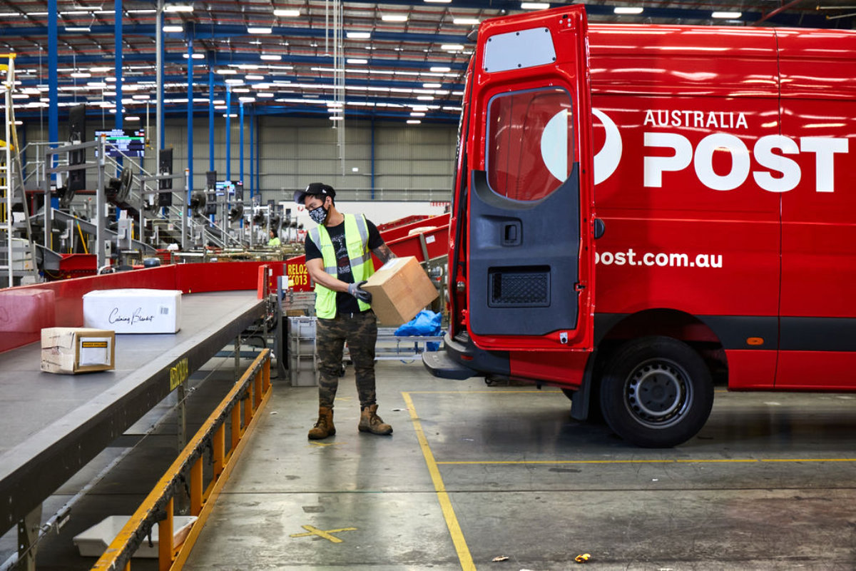 Australia Post sorting facility with parcel delivery van