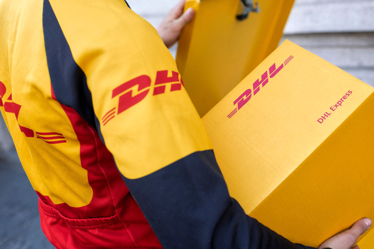 DHL Express delivery driver with parcel