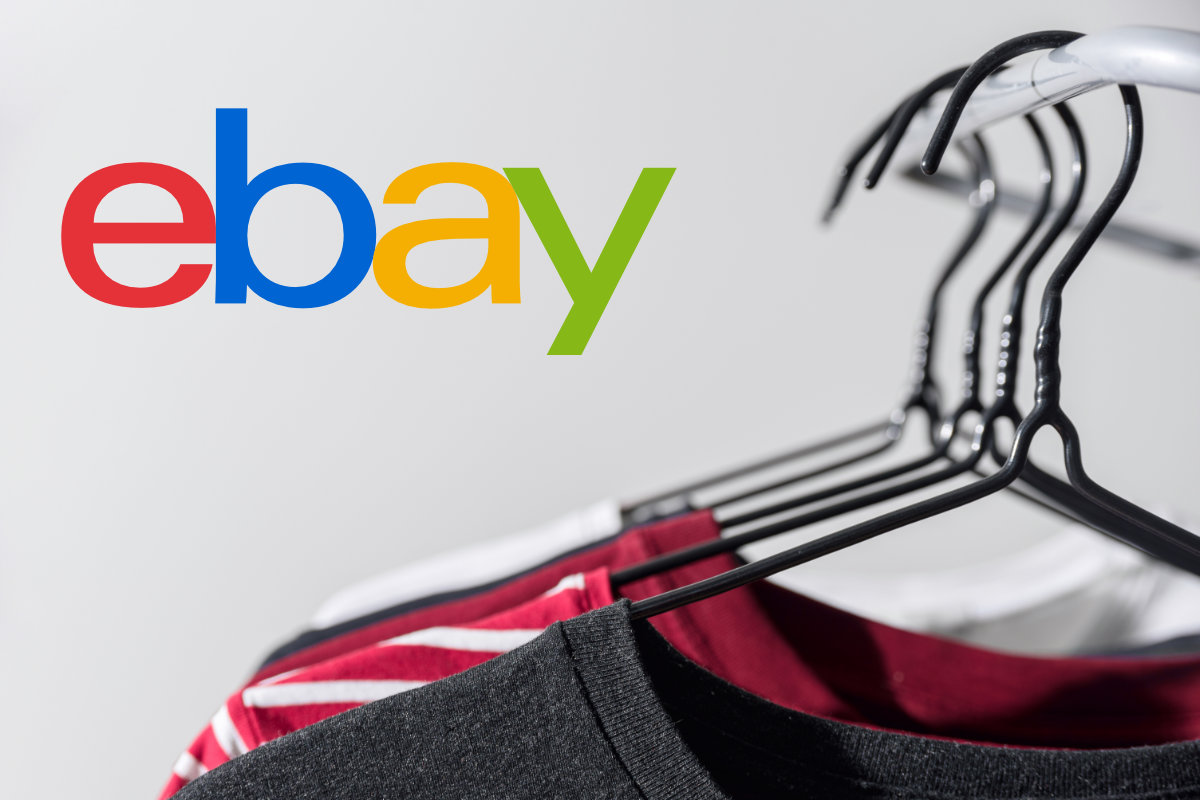 eBay logo with second-hand clothing on rack
