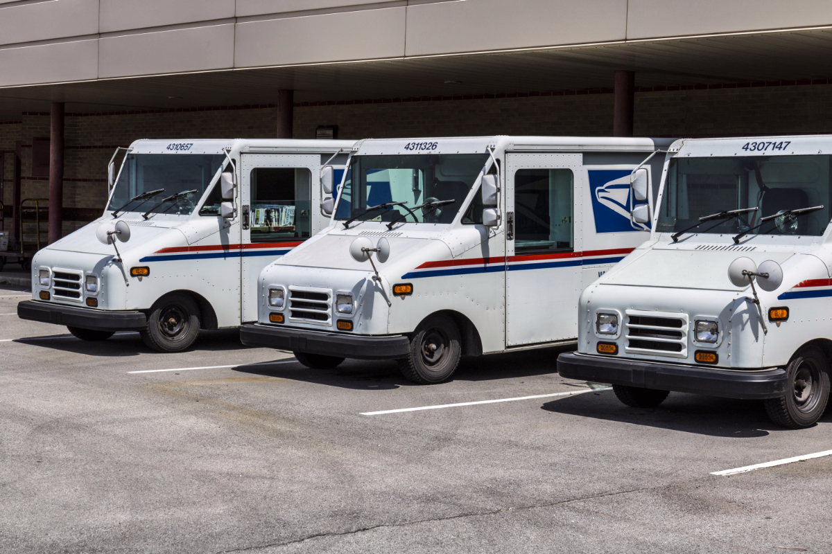 USPS delivery trucks parked at mail prodessing facility