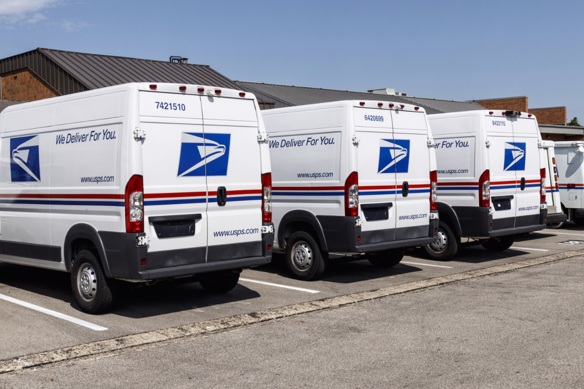 USPS trucks parked at a post office
